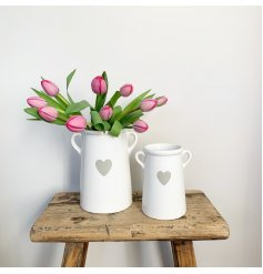 A pretty white and grey ceramic pot with ears. Complete with a classic heart design.