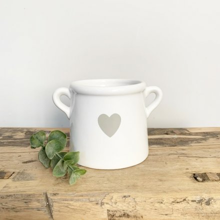 A stylish ceramic pot with twin ears and a pretty grey heart design.