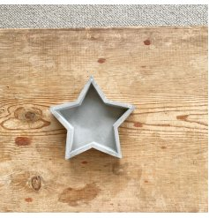 An effortlessly chic cement star tray with a raw and rustic finish.