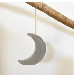 An on trend, rough luxe cement moon decoration with a jute string hanger.