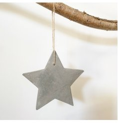 A rustic hanging star decoration made from cement. Complete with a jute string hanger.
