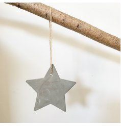 A rustic cement star decoration with a jute string hanger.