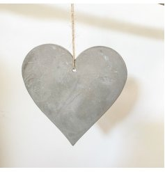 A rough luxe cement heart decoration with jute string hanger.