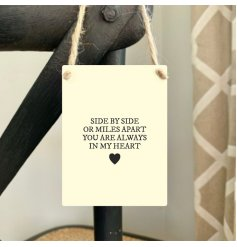 A beautiful sentiment slogan written onto a mini metal sign. Complete with jute string hanger.