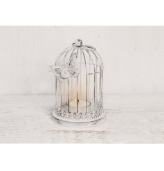 Set with an overly distressed white wash charm, this tlight holder with an added butterfly decal will be perfect for an