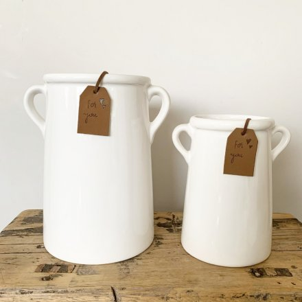 A timeless white ceramic vase with eared handles. Complete with a tan coloured PU Leather tag