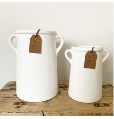 A rustic living ceramic vase with small eared handles. Complete with a stamped 'for you' PU leather tag.