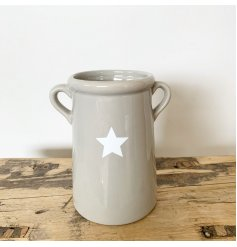 A simple, but perfectly formed grey vase with a white star shaped decal. Complete with twin handles.