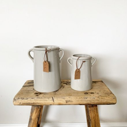 An attractive tall grey vase with eared handles and a PU leather tag which reads 'for you'