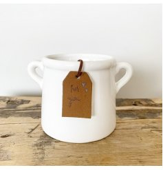A timeless white ceramic pot planter with a PU leather tag reading 'for you'.
