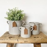A chic ceramic pot planter with a grey washed finish. Complete with eared handles and a PU leather tag in tan.