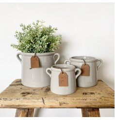 A rustic living grey pot planter with twin handles. Complete with a stylish PU leather tag which reads 'for you'.