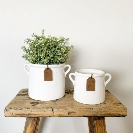 A simple and stylish white ceramic pot planter with a tan coloured PU leather tag reading 'for you'.