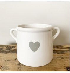 A classic white ceramic pot with a grey heart detail. Complete with twin handles.