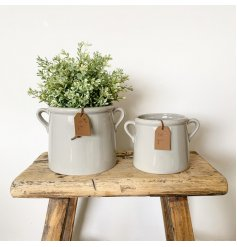 A stylish ceramic pot with a grey finish. Complete with small handles and a rustic PU leather tag which reads 'for you'