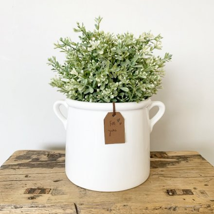 A classic white ceramic pot planted with a 'just for you' stamped PU leather tag.
