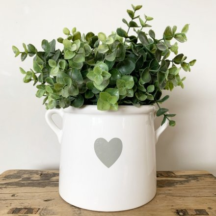 A chic ceramic pot with twin handles. Complete with an attractive grey heart design.