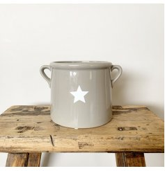 A simple and stylish grey ceramic pot with a star detail and small twin handles.