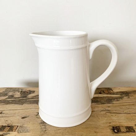 A classic and beautifully simple white ceramic jug with plenty of country character and charm.
