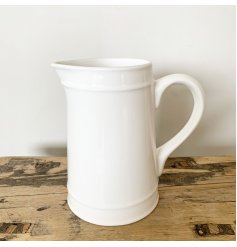 A gorgeous white ceramic jug for laid back living. Classic and timeless this item is a must have.