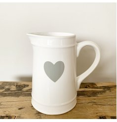 A simple and stylish white ceramic jug with a grey heart detail. A gorgeous, must have interior accessory.