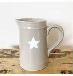 A chic grey ceramic jug with a white star pattern. A beautifully simple homeware item with plenty of style.