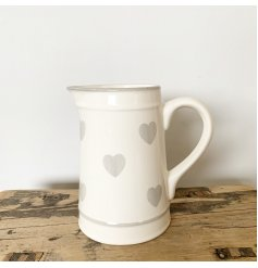 A chic ceramic jug with grey washed hearts. A classic item to compliment many interior styles and tastes