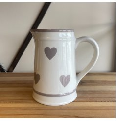 A beautiful and classic ceramic jug with a washed grey heart pattern.
