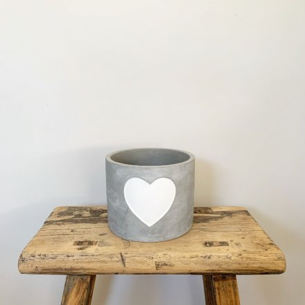 A beautiful grey cement pot with a chic white painted heart.