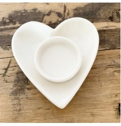 A classic white t-light holder set within a chic ceramic heart.