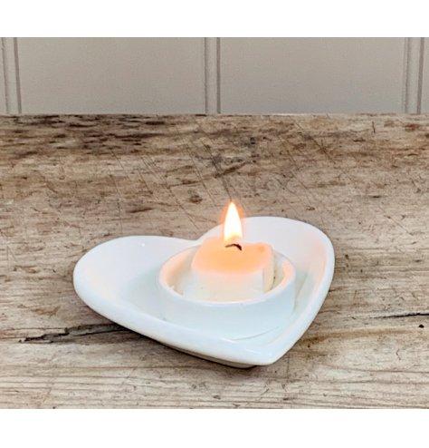 A stunningly simple Ceramic White T-light Holder in Heart Design