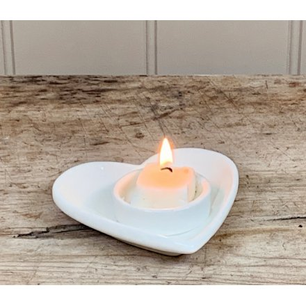 A simple yet perfectly formed heart shaped t-light holder in white.