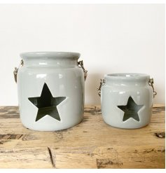A rustic ceramic lantern with a star shaped cut out design. Complete with a chunky rope handle.
