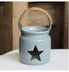 A chic grey lantern with a chunky rope handle. Complete with a star shaped cut out design to reveal your candle.