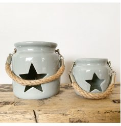A rustic grey lantern with a star shaped cut out design. Complete with a chunky rope handle.