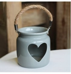 A chic grey ceramic lantern with a charming heart cut out detail. Complete with a chunky rope handle.