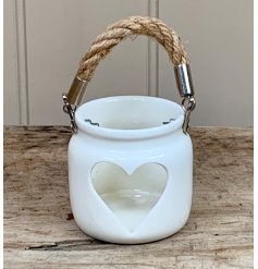 A beautifully simple lantern with a heart shaped cut out design. Complete with chunky rope handle.