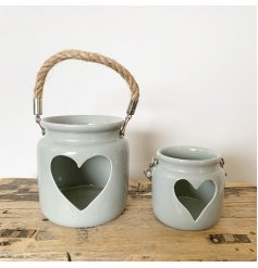 A rustic grey lantern with a heart shaped cut out feature. Complete with a chunky rope handle.