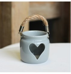 A rustic living ceramic t-light holder with a heart shape detail and chunky rope handle.