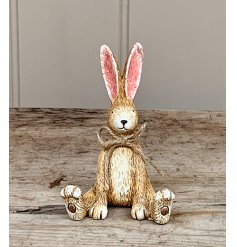 A charming and perfectly formed sitting rabbit decoration. Complete with pointed ears and a jute string bow.