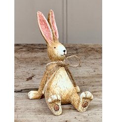 A charming and beautifully simple sitting rabbit ornament. Complete with a jute string bow and textured finish.