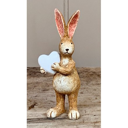 A charming standing rabbit ornament with tall pointed ears and a white heart.