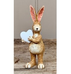 Fall in love with this simple and chic standing rabbit decoration with white heart decoration.