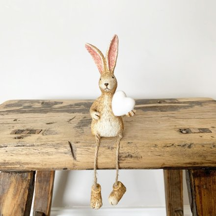 A charming shelf sitting rabbit decoration with jute string dangling legs.
