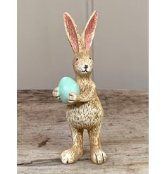 A unique and utterly charming rabbit decoration, complete with a green polka dot egg.