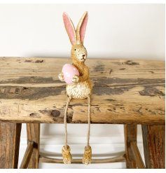 Adorn your shelves with this adorable sitting rabbit ornament. Beautifully textured and detailed.