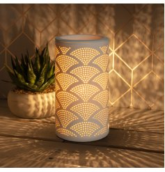 A stylish and contemporary aroma lamp with a fan design.