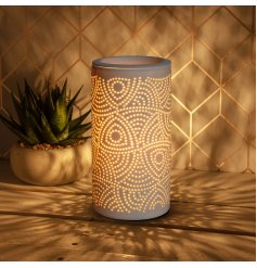 A super stylish aroma lamp with a warming glow. Complete with gift box.