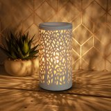 An attractive and contemporary aroma lamp for wax melts. Creating a warming and ambient glow in the home.