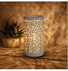A beautiful aroma lamp for wax melts. A stylish interior accessory creating a warming atmosphere in the home.